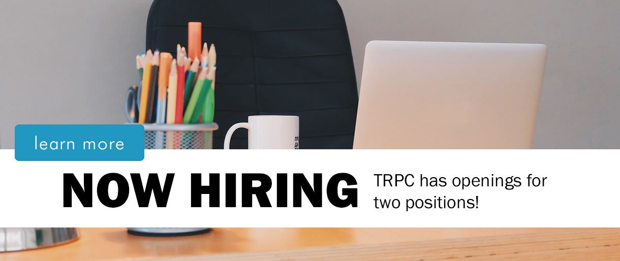 "Image of empty desk that says ""Now Hiring. TRPC has openings for two positions. Learn more."""